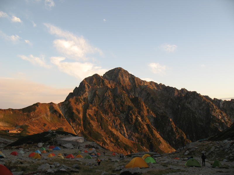 Tsurugi-dake at sunset. Campsite in the foreground.